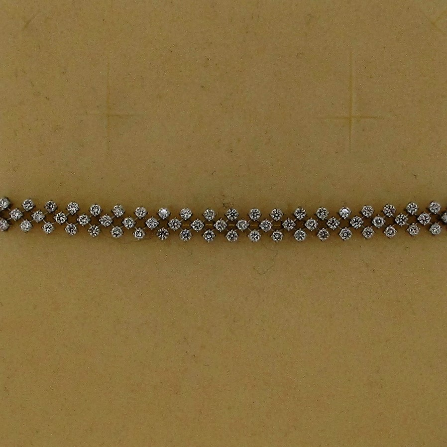 "An 18ct white gold hallmarked  7"" Diamond set bracelet"