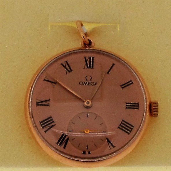 An 18ct rose gold circular Omega ladies manual pocket watch.