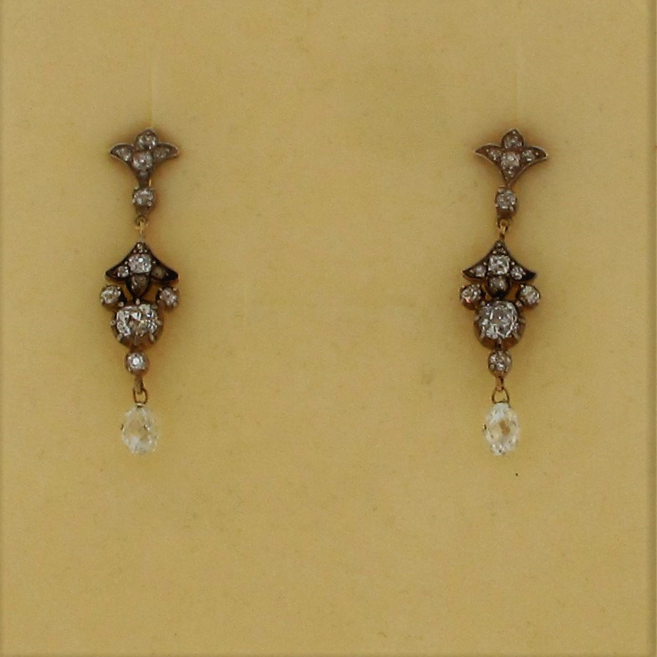 A pair of Edwardian drop Diamond earrings with 14 Diamonds