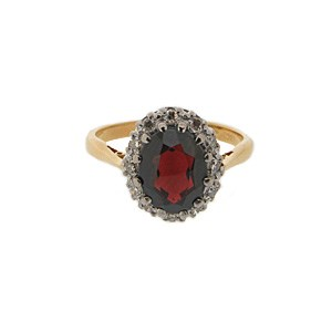 Platinum oval garnet and diamond ring