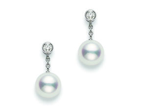 A pair of Mikimoto drop pearl and diamond earrings