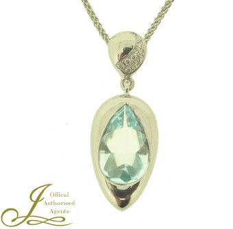 18ct white gold blue topaz pendant with diamonds.