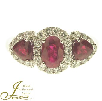 An 18ct white gold Ruby and Diamond three stone cluster ring